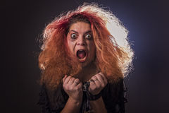 Crazy witch laughing histerically Royalty Free Stock Image