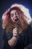 Crazy witch laughing histerically Royalty Free Stock Photography