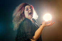 Crazy witch laughing histerically Royalty Free Stock Photo