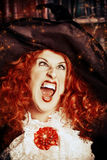 Crazy witch. Portrait of a pretty funny witch in the wizarding lair. Fairytales. Halloween Royalty Free Stock Image