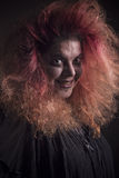 Crazy witch smiling sinisterly Royalty Free Stock Images