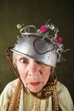 Crazy Woman. Wearing a metal colander for a helmet Stock Image