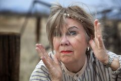 Crazy Woman. Crazy old woman outdoors with wild makeup Royalty Free Stock Photo