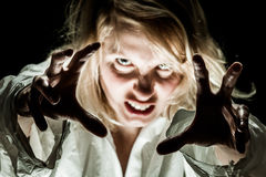Crazy Woman acting like a Zombie. Focus on hands Royalty Free Stock Photography