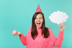 Crazy woman in birthday hat screaming, holding cake with candle, empty blank Say cloud, speech bubble for promotional. Content isolated on blue background royalty free stock photo