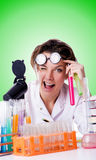 Crazy woman chemist in lab Stock Photo