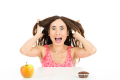 Crazy woman on diet screaming. Diet woman cannot decide what to eat and looking like crazy. Isolated on white background stock image