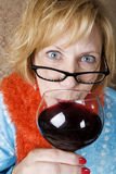 Crazy Woman Drinking Wine Royalty Free Stock Images
