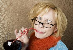 Crazy Woman Drinking Wine. Crazy woman with crossed eyes drinking wine through a straw Stock Photos
