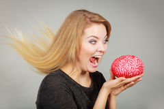 Crazy woman holding brain wanting to eat it Royalty Free Stock Image