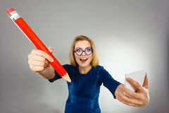 Crazy woman holds big pencil in hand Stock Photography