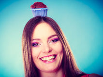 Crazy woman holds chocolate cake on head Stock Image