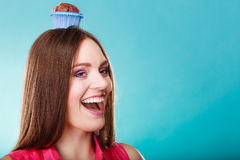 Crazy woman holds chocolate cake on head Royalty Free Stock Photo
