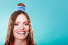 Crazy woman holds chocolate cake on head Royalty Free Stock Image