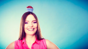 Crazy woman holds chocolate cake on head Stock Photo
