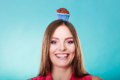Crazy woman holds chocolate cake on head Stock Photos