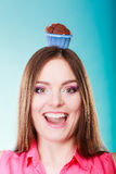 Crazy woman holds chocolate cake on head Royalty Free Stock Images