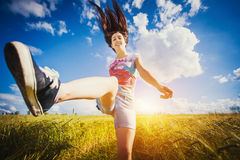 Crazy Woman jumping on green field Royalty Free Stock Images