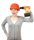 Crazy woman with orange hard hat and drill Stock Images