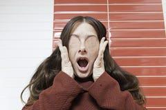 Crazy woman paranoid Stock Images