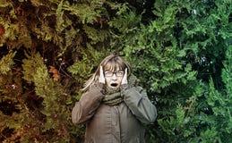 Crazy woman paranoid Stock Photo
