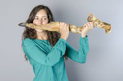 Crazy woman playing a transverse flute with leg ham finished. Ma Royalty Free Stock Photography