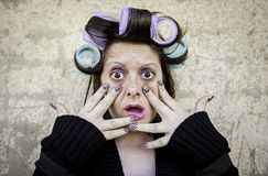 Crazy woman presses Stock Photography