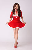 Crazy woman in red xmas sexy costume Stock Photography