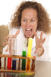 Crazy woman scientist with test tubes foam grab Royalty Free Stock Photos