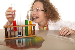 Crazy woman scientist with test tubes grab red Royalty Free Stock Photo
