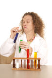 Crazy woman scientist with test tubes scrunch face Stock Photography