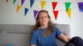 Crazy woman shake long hair and show tongue look at camera. Gimbal slow motion stock footage