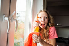 Crazy woman washes a window Royalty Free Stock Image