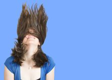 Crazy womans hair over a blue background Royalty Free Stock Image