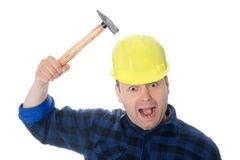 Crazy worker. Is hitting him self in head with hammer Stock Photography