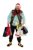At crazy Xmas sale for vagrant. Joyful vagrant holding Christmas shopping bags Royalty Free Stock Photo