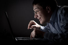 Crazy young adult man with laptop Stock Photography