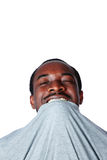 Crazy young african man biting his t-shirt Royalty Free Stock Photo
