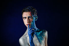 Crazy young androgyne man with face art. SPACEMAN. Freak person. Royalty Free Stock Photo