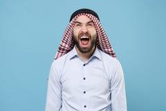 Crazy young bearded arabian muslim man in keffiyeh kafiya ring igal agal casual clothes  on pastel blue