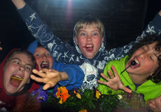 Crazy young boys. Crazy boys with their lollies in a funny gesture during Easter holiday in Gluckstad, Germany stock images