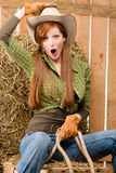 Crazy young cowgirl horse-riding country style. In barn Stock Photos