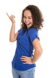 Crazy young girl in blue presenting with her finger. Stock Photos