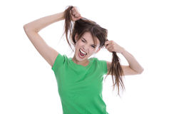 Crazy young girl playing with her hair making grimace. Stock Photo