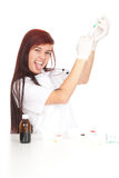 Crazy young lady doctor holding syringe Stock Images