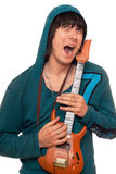Crazy young man with a little guitar Stock Images