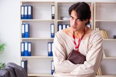 The crazy young man in straitjacket at the office stock photos