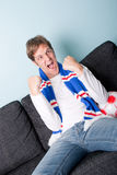 Crazy young man watching football Royalty Free Stock Photo