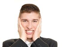 Crazy young man at work Royalty Free Stock Photos