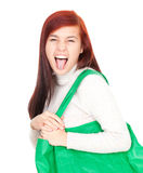 Crazy young woman with green shopping bag Stock Photography